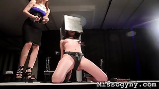 Mistress spanks a dutiful teen just about her dungeon
